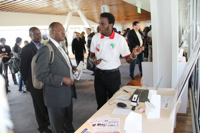 Faculty, Prof Lynn Atuyambe-School of Public Health (front) flanked by the Makerere University DVC- Prof. Barnabas Nawangwe in the Innovation Marketplace at TechCon2014