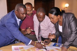 Dr Roy Mayega, RAN deputy Chief Of Party (Center) actively participating in the CRID workshop