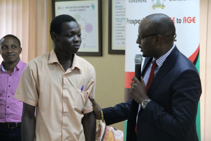Winner 1 RAN MKITs (Video) Challenge. One on one with Maurice Mugisha as pne of the judges (behind) looks on