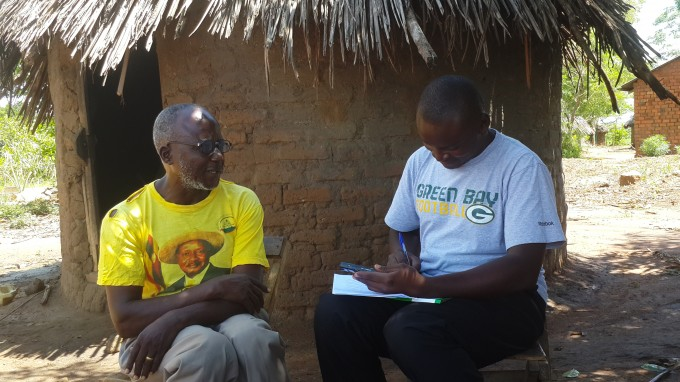 1.Emma Ngolobe ,research assistant with the low cost solar Irrigation pump conducting an interview with one of the stakeholders in Gogonyo sub-county Pallisa district