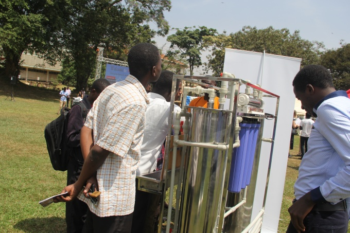 People engaging with the Water Purification innovation team at the exhibition